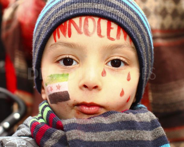 A young protester with face paint opposite the Syrian Embassy.