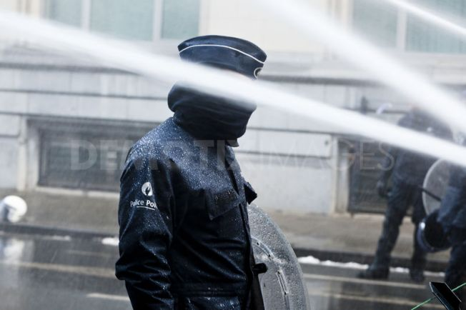 Firemen use foam and water on government buildings over austerity cuts.