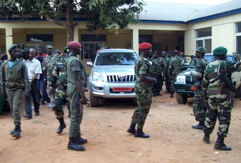 AP: Military soldiers of Guinea-Bissau leave a building on April 13, 2012 after a meeting in Bissau
