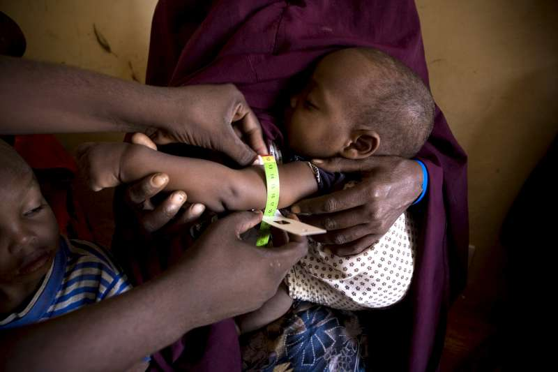 Child being measured for signs of malnutrition