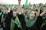 Supporters of main challenger and reformist candidate Mir Hossein Mousavi shout amidst a festive atmosphere at an election rally at the Heidarnia stadium in Tehran, Iran, Tuesday, June 9, 2009. (AP Photo/Ben Curtis)