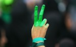 A supporter of candidate Mir Hossein Mousavi holds up a painted hand during a campaign rally at Haydarniya Stadium on June 9, 2009 in Tehran, Iran. (Majid/Getty Images)