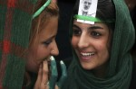 Supporters of former Mir Hossein Mousavi wear the green colors of the campaign as they attend a pre-election gathering at a stadium in Tehran June 9, 2009. (REUTERS/Damir Sagolj)
