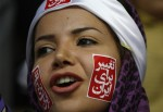 "A supporter of presidential candidate, Mahdi Karroubi, chants slogans, with stickers on her face and head scarf reading ""change for Iran"" at a campaign gathering in Tehran, Iran, Tuesday, June 9, 2009. Karroubi, a challenger to the hard-line President Mahmoud Ahmadinejad, is a former parliament speaker and the only cleric in the June 12 election race. (AP Photo/Vahid Salemi)"