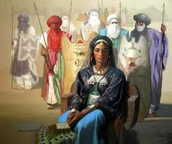 "Tin Hinan is the name given by the Tuareg to a 4th-century woman of prestige whose monumental tomb is located in the Sahara at Abalessa in the Ahaggar or Hoggar region of Algeria. The name means literally ""she of the tents"", but may be metaphorically translated as ""mother of the tribe"" (or ""of us all"") or even ""queen of the camp"" (the ""camp"" maybe referring to the group of tombs which surround hers). She is sometimes referred to as ""Queen of the Hoggar"", and by the Tuareg as tamenoukalt which also means queen."