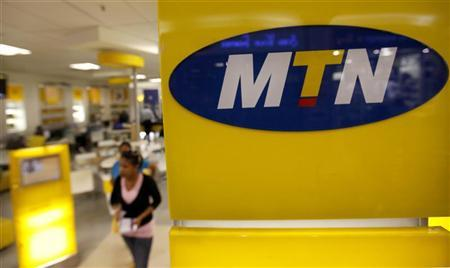 A customer leaves an MTN shop in Johannesburg April 10, 2012. REUTERS/Siphiwe Sibeko