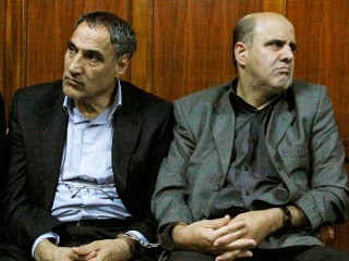 Iranian nationals Sayed Mansour Mousavi, left, and Ahmad Abolfathi Mohammad, right, are seen in this June 27, 2012 file photo in the Nairobi magistrates court in Nairobi, Kenya. (Khalil Senosi/AP)
