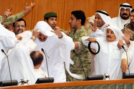 Kuwaiti Shiite and Sunni MPs fight during a heated parliament debate over inmates in the US Guantanamo detention centre. Yasser al Zayyat / AFP Photo