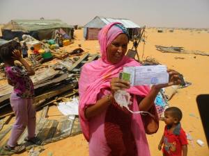 Woman from the Leimghetty neighbourhood of Dar Naim near Nouakchott shows her legal title to build on the land where the state just destroyed her home and is now ignoring demands for re-housing or compensation